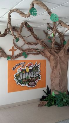 Our VBS Jungle Tree for advertisement at church. by estelle Deco Jungle, Jungle Party, Safari Party, Safari Theme, Jungle Safari, Vbs Crafts, Diy And Crafts, Crafts For Kids, Jungle Decorations