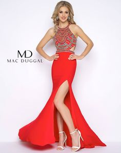 Halter neck, beaded bodice, crepe jersey prom dress with high slit, small train and cut out details at the waist. Available in Red/Multi.