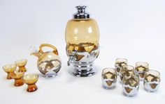 "Group of Farber Brothers Krome Kraft Barware, 12 pieces, some with amber Cambridge Glass; including: decanter with adjustable spout; 4.5 ounce wine glasses; tilted glass decanter with four cordials; 1.75""-10.5"" high #kromekraft #farberbrothers #wickliffauction"