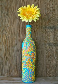 Hand Painted Wine bottle Vase, Turquoise bottle with sunshine yellow, orange and pink accents, Vibrant Henna style design via Etsy
