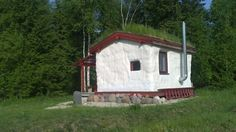 So quaint!  I could also see it painted a saffron color.  Tiny Cob House with Living Roof in an Eco Village