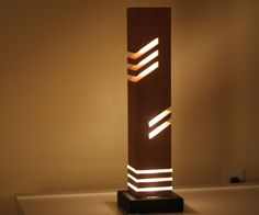 "This is a modern looking decorative table light made from wood (cedar) 5cm diameter acrylic rod and a steel base.IF YOU LIKE THIS PROJECT, DON'T FORGET TO VOTE IT IN THE ""LIGHTS"" CONTEST, PLEASE &THANK YOU."
