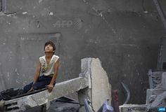GAZA CITY : A Palestinian boy sits on the rubble of a destroyed building following an Israeli air strike in the center of Gaza City on July 22, 2014. A series of Israeli air strikes early today killed at least seven people in Gaza, including five members of the same family, an emergency services spokesman said.AFP PHOTO / MOHAMMED ABED