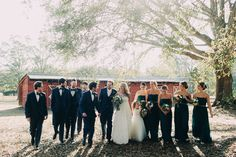 Chic wedding party in tuxes + black dresses