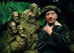 William Ricketts – (1898-1993), posing with one of his sculptures. Photo by Ern Mainka