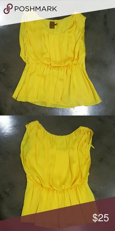 Ali Ro cinched waist,  peplum top Bright yellow,  flowing and forgiving. So cute with jeans. 100% polyester. Ali Ro Tops Blouses