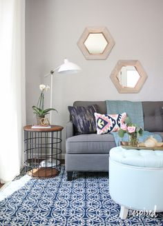 One of my favorite pieces in this space is the side table (from HomeGoods). It adds great texture and interest to the space. Plus, the top is on a hinge so you can store things inside like pillow, magazines, etc. Double duty piece for the win! *sponsored pin*
