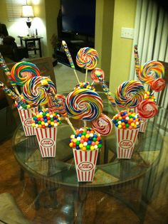 Our version of this fun centerpiece idea. We used combination of tacky glue & large glue dots to hold the gumballs in place.