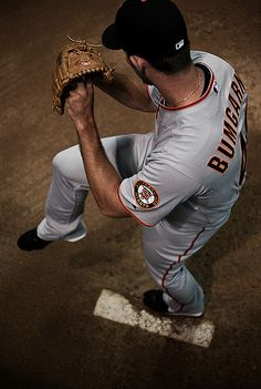 7/24/10. Photo by Stuart Ballew, who took this cool photo of 20-year old rookie Madison Bumgarner warming up in the bullpen in Arizona. Less than 4 months after this shot was taken, the Giants were World Series champs. Who knew?