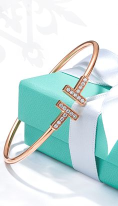 It's all in the wrist. Tiffany T wire bangle in 18k rose gold with diamonds.
