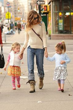 Sarah Jessica Parker does double duty, going hand in hand with her twins Tabitha and Marion, as they go for a walk around New York City.