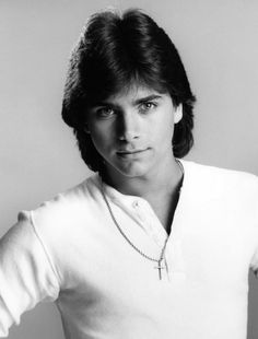John Stamos- the ONLY posters I hung in my room were of him.  This was one of them!