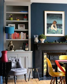 Gorgeous dining room with Hague Blue walls and alcove shelving in Lamp Room Gray