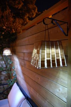 These outdoor pendant lights were created using plant hangers, solar lights, chain, and baskets from the dollar store. What an easy and creative way to light your backyard living space! Backyard Projects, Outdoor Projects, Garden Projects, Diy Projects, Backyard Ideas, Project Ideas, Outdoor Deck Lighting, Outdoor Decor, Outdoor Lantern