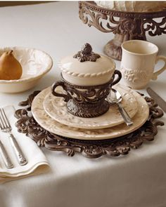 GG Collection 20-Piece Ceramic Dinnerware Service - love the covered soup bowl and charger plate! Via Neiman Marcus.