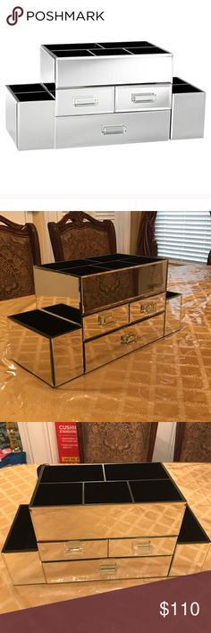 Pottery Barn Large Makeup Storage Unit - Gorgeous mirrored vanity for storage. It can  be perfect for a bathroom vanity or makeup storage. I was able to fit a TON of makeup in this. The only reason I'm selling it is because it doesn't match with my current space.  - there are 3 pull out drawers and 7 storage spaces on top.  - the back is not mirrored.  - it's heavy and amazing quality - dimensions :20x 8.5x 10 Pottery Barn Other
