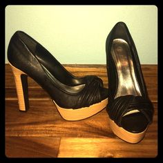 Black high heels These black leather heels have a wood heel and platform. Only worn a few times! No damage! Deb Shoes Platforms