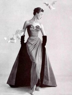Ivy Nicholson in cherry red evening gown designed by Pierre Balmain of acetate for Celanes Corporation of America, 1951