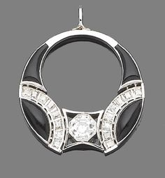 A diamond and onyx pendant.  The pendant set to the centre with an octagonal-cut diamond, within a step-cut diamond and onyx border. Art Deco or Art Deco style.
