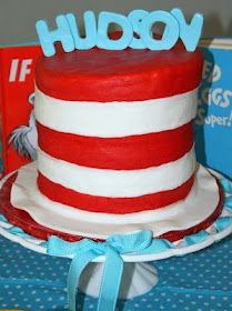 Cat in the Hat Cake! We made one but stacked it leaning, used fruit roll ups for red stripes and put the cutest Thing 1 & 2, red fish/blue fish, and yellow Lorax mustache cake pops on top of hat! So awesome! B