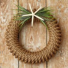 Hampton Wreath with Starfish/Greens from Stonewall KitchenAdd a dash of coastal nautical charm to your home with this attractive Hampton Wreath from Stonewall Kitchen. An easy DIY with a foam wreath form and two different sized ropes. Wreath Crafts, Diy Wreath, Door Wreaths, Christmas Door Decorations, Christmas Crafts, Christmas Ornaments, Nautical Wreath, Starfish Wreath, Chevron Burlap Wreaths
