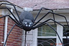 "Previous Pinner said: A 25' spider web needs a big spider. So I hand carved from blue styrofoam the body. Then painted it with black latex house paint and made legs out of 3/4"" and 1/2"" PVC. The eyes are made from the cheap toys in the supermarket gumball machine containers. The cap was removed then inlayed into the foam. to back them I use 3M reflective tape so when you shine it with a flashlight it looks like real eyes. Then I added LEDs to all 8 eyes to make them glow red."