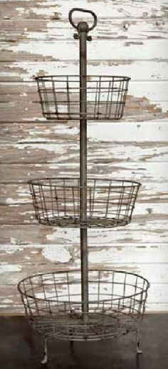 Super utility piece makes a statement anywhere you use it! Measuring just shy of 3 feet tall, it has 3 wire baskets around a center pole with top loop handle and 3 'feet' at the base. Perfection in th