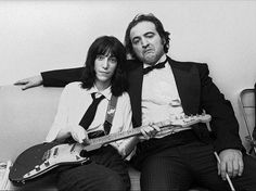 Patti Smith and John Belushi backstage at Saturday Night Live, April 17, 1976, by Allan Tannenbaum