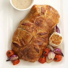 Beef tenderloin wrapped in a flaky pastry with mushrooms, shallots, and garlic makes a savory and delicious main course for your holiday meal: http://www.bhg.com/christmas/recipes/christmas-dinner-menus/?socsrc=bhgpin121414boeufencroute&page=13