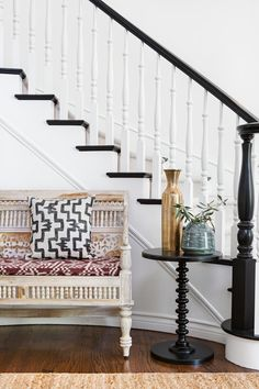 Antique entry bench and striped pillow | Chad Mellon