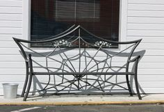 This spider web bench is in front of a tattoo business. It's not a Halloween decoration, just their regular theme.