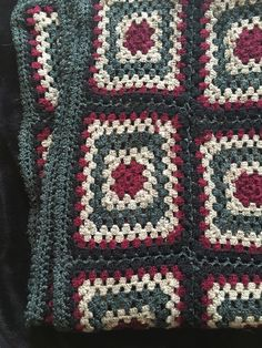 A personal favorite from my Etsy shop https://www.etsy.com/ca/listing/258225613/granny-square-throw-black-grey-beige-red