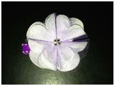 purple floral hair clip with dark purple ribbon. $5 shipped  www.facebook.com/GabbyAbbyBoutique