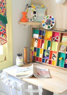 Love this idea! Liven up an old drawer by painting the little compartments and then make it a vertical display!