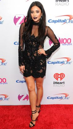 Shay Mitchell in a sheer black lace mini dress