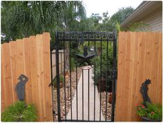 wrought iron gate wood fence
