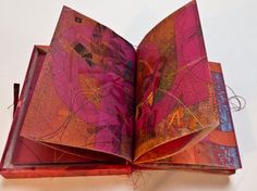 Red - Redder - Reddest by Pat Hodson |  Continuous Fold Book - 19.5 cm x 15 cm. With stitched pages which collapse into a soft integral cover. Multiple of 10 - each with a different mixed media substrate. September 2011