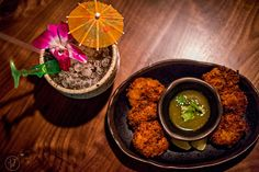 Wednesday, November 2015 After finishing up at Himitsu Lounge in Buckhead, I headed over to Decatur to see the newly opened S., tiki torches light th… Fried Coconut Shrimp, Fried Shrimp, Tiki Lights, Bar Interior Design, How To Make Drinks, Tiki Torches, Spare Ribs, Served Up, Restaurant Design