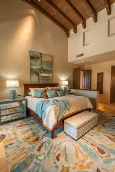 Transitional Master Bedroom with Carpet, Cathedral ceiling, Exposed beam, limestone tile floors