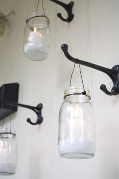 Use wall hooks to hang mason jars and create soft candle light on your outdoor porch. Anything to do with mason jars! Pot Mason Diy, Mason Jar Crafts, Hanging Mason Jars, Mason Jar Lighting, Jar Lanterns, Jar Candles, Citronella Candles, Hanging Lanterns, Ideas Lanterns