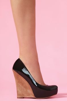 I used to hate the way wedges look, but find myself increasingly attracted to them. Old age? (Slick Platform Wedge - Black)