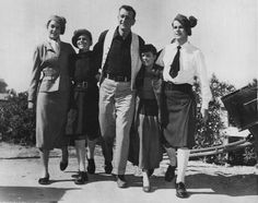 John Wayne on the set of The Quiet Man with his children from his first wife, Josephine Saenz. From the left: Antonia, Patrick, Melinda and Michael. They all had bit parts in the film...