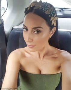 Dripping with jewels: The NRL WAG accessorised with a patterned clutch and, of course, her...