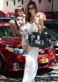Miranda Kerr street style with white maxi dress and Hermes handbag.