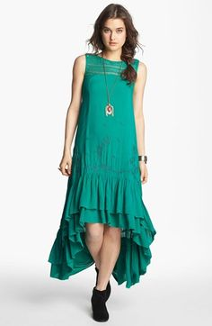 I really want a swingy emerald dress to wear with big boots.  Will have to think on how such a thing could be made nursing-friendly.