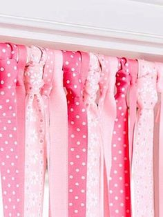 Hang lengths of grosgrain ribbon in different patterns or colors from a curtain rod mounted inside the window frame. Cute idea!