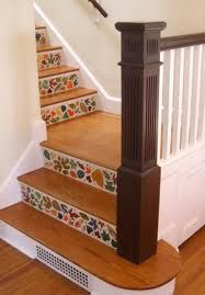 Ceramic tiles on stairs. Too cute! I wan to do this to my stairs.. ceramic tiles on the backs of each wood stair... cute...