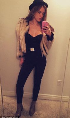 Are you fur real? Bella Thorne came under fire as she posted this outfit of the day image on Instagram but claimed her jacket was made from 'faux fur'