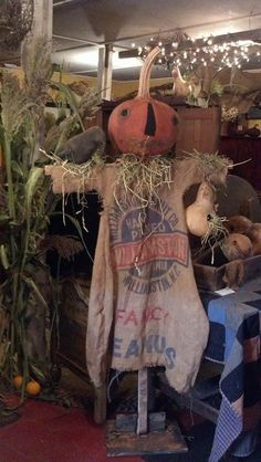 Fall scarecrow with feed sack clothes. Gatherings Shop - Sweetpeas Primitives