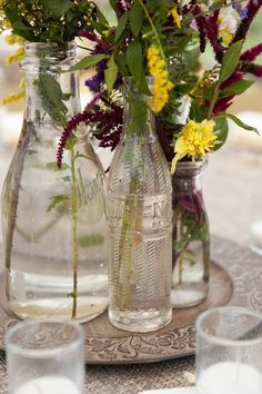 clear glass bottle centerpieces